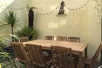 Mediterranean Style Patio Garden with Teak Table seating 8