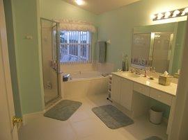 En Suite showing bath and Walk in shower