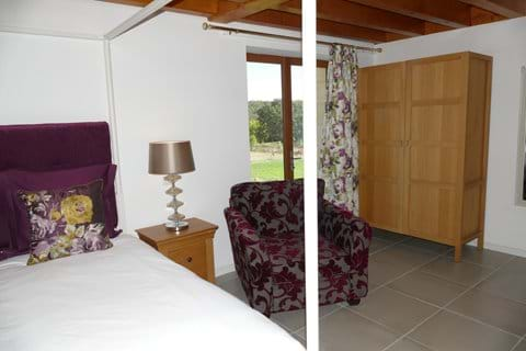 Bedroom One in Le Noyer is located on the ground floor with french doors to the garden
