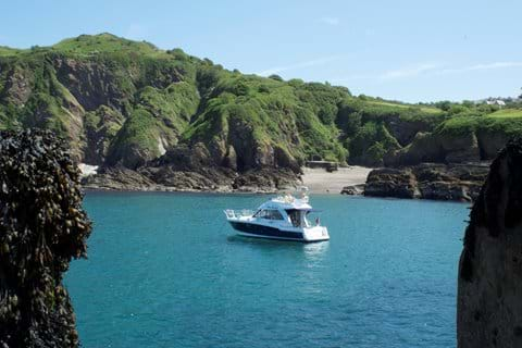 A boat morred off Rapperee Cove near Ilfracombe