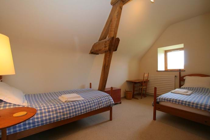 The second twin bedroom in The Barn, Boudet, Normandy which shares the family bathroom with the second twin bedroom