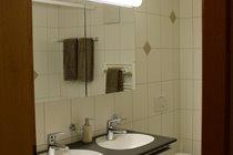 Modern bathroom with twin sinks.