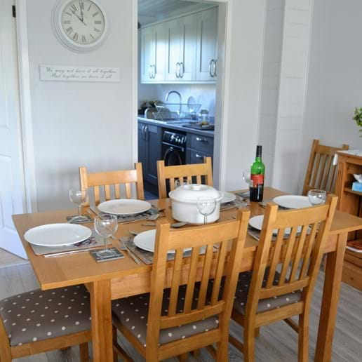 Dining area with extending table seating 6