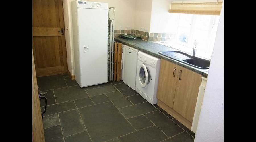 Utility room with washing machine, tumble dryer and boot dryer