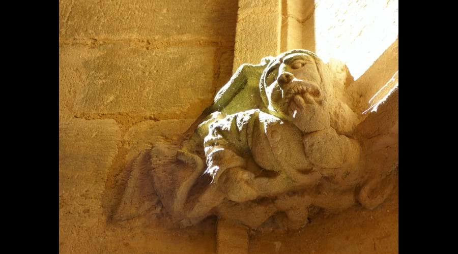 Medieval gargoyle above the doorway