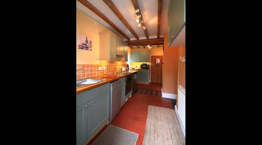 Modern fully equipped kitchen with hob, oven, dishwasher, fridge, freezer, microwave and even a pantry