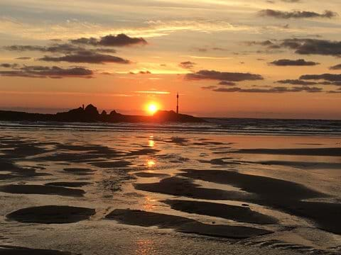 Not to be missed.  The sun setting over the Breakwater, Bude