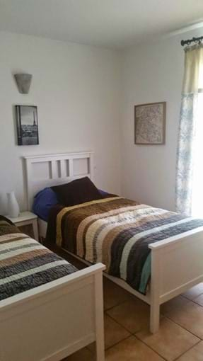 Front twin bedded room with french doors to balcony
