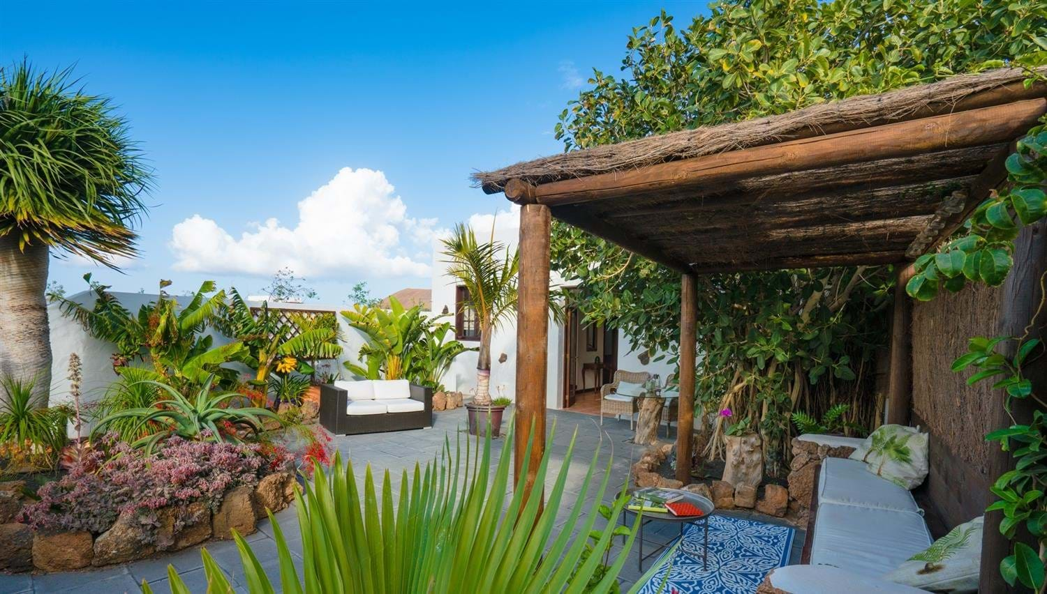 View of the garden and outdoor seating in the Garden Apartment at Finca Botanico, Lanzarote