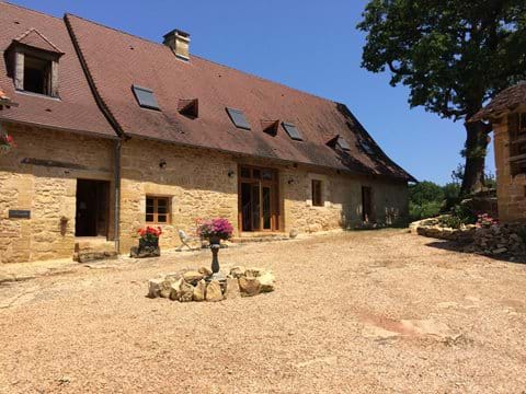 The sun drenched courtyard of luxury Gites in the Dordogne