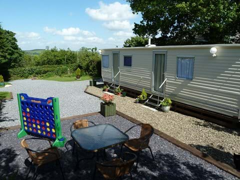 Two Traditional Holiday Caravans, Set in their own garden setting with great views.
