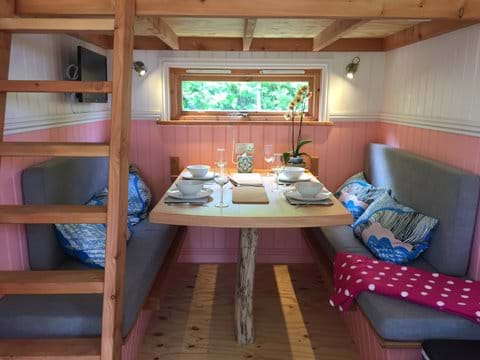 Dining/sleeping area at one end of the wagon