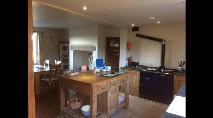Bespoke wooden kitchen with electric Aga