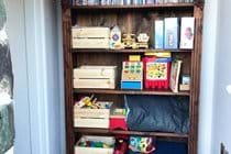 Toys, books & DVDs in the lounge ready for younger guests