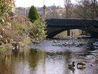 THE RIVER SETT FLOWS THROUGH HAYFIELD VILLAGE