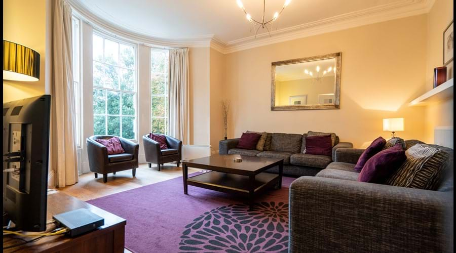 Sitting Room with 2 large sofas, 2 easy chairs, coffee table, Smart TV with Sky Sports, DVD player