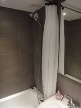Fully tiled bathroom with shower