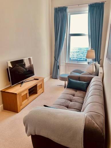 Useful TV room with beautiful sea and island views