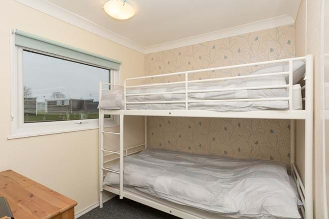 2nd bedroom with TV & DVD player, full size bunk beds