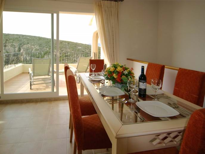 Dining table for 6 with views across the terrace to the sea