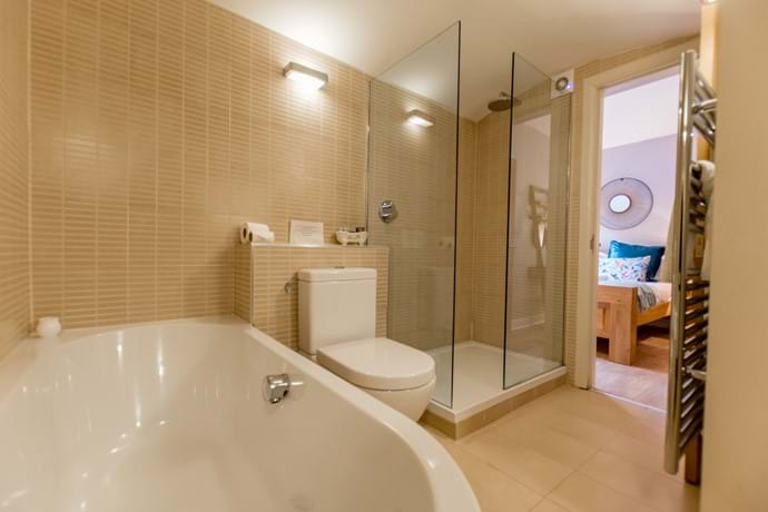 Bathroom has dual access from main bed and hallway for the twin bedroom