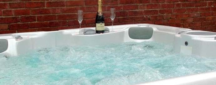 hot tub at riverside cottage
