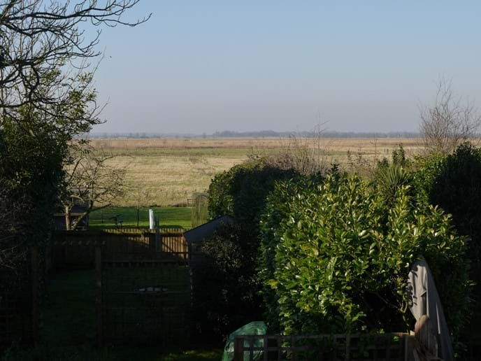 View over garden and marshes