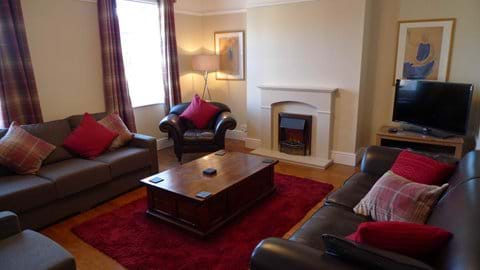 Lounge with lots of comfortable seating and TV with Sky Sports