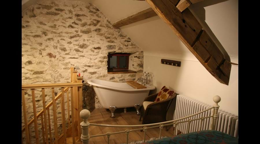 Upstairs Bedroom in Cwch Gwenyn (Beehive) with Roll Top Bath