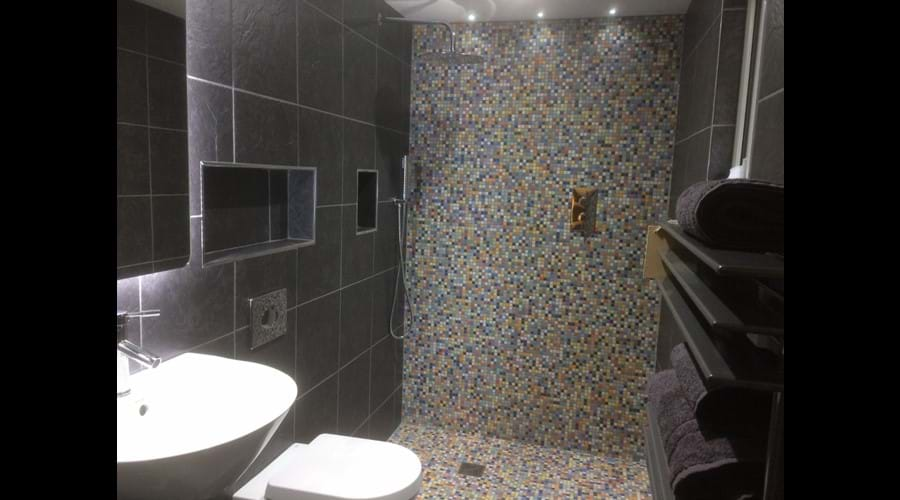 The fully-tiled wet room on the ground floor is perfect for washing down muddy dogs (or children).