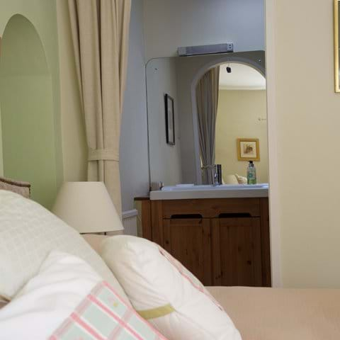 small dressing room leads off the main bedroom