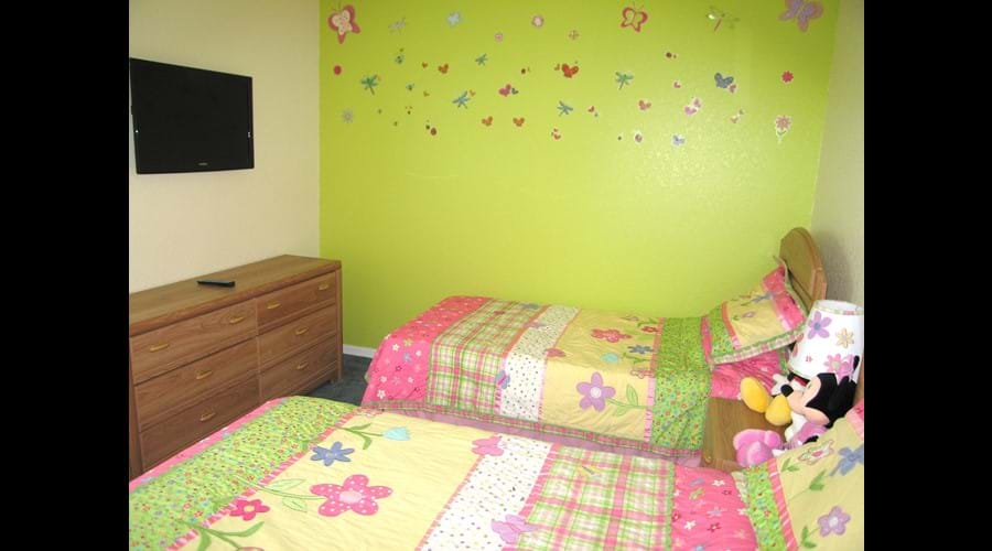 "Girls Bedroom with Butterfly theme & 32"" wall mounted TV"