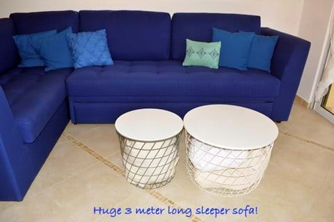 Bedding for Sofa-Bed Conveniently Located in Coffee-Table Baskets