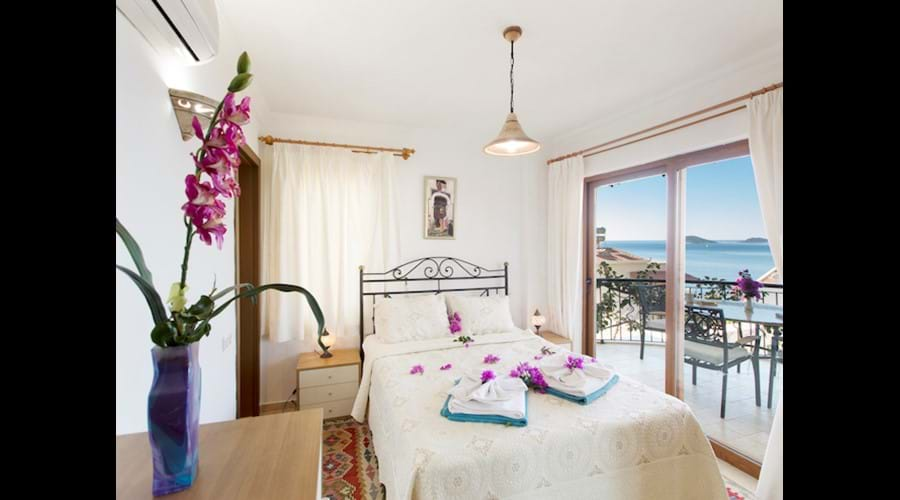Kalamar Meltem Apartments Master Bedroom with Balcony and Sea Views