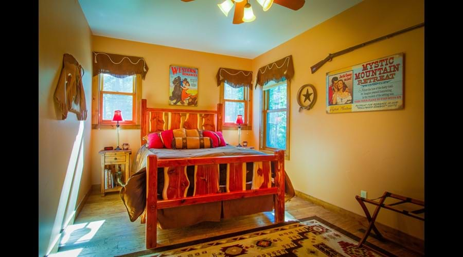 Hollywood Cowboy room with queen log bed