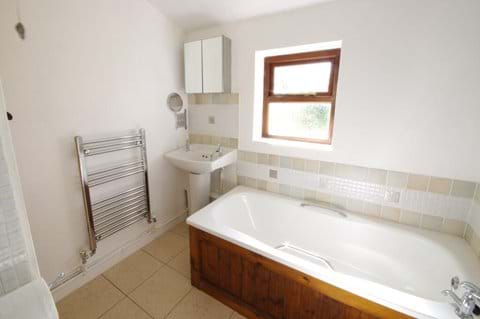Bathroom with free standing shower