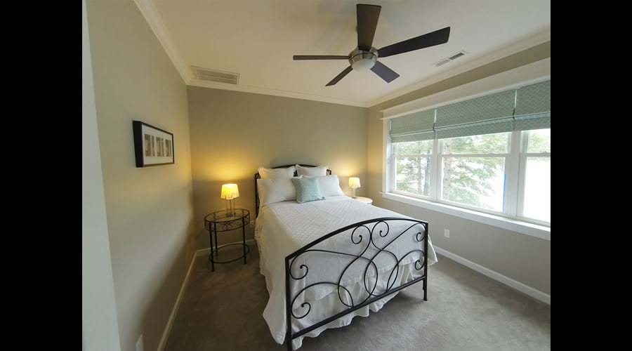 Bedroom 3 on First Floor. Large window with lake view