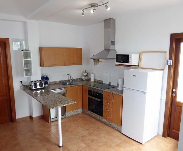 Kitchen Area - door on right to Solana (Washing Machine) - door left to Bedroom 1