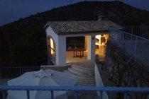 Evening in the covered pergola area.