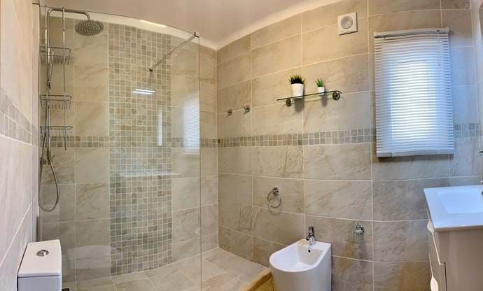 Main bathroom with walk in shower and modern suite, mirror over sink