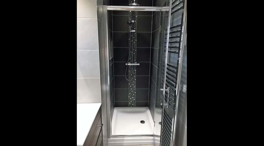 Ensuite to master:  fully tiled shower cubicle with thermostatic shower
