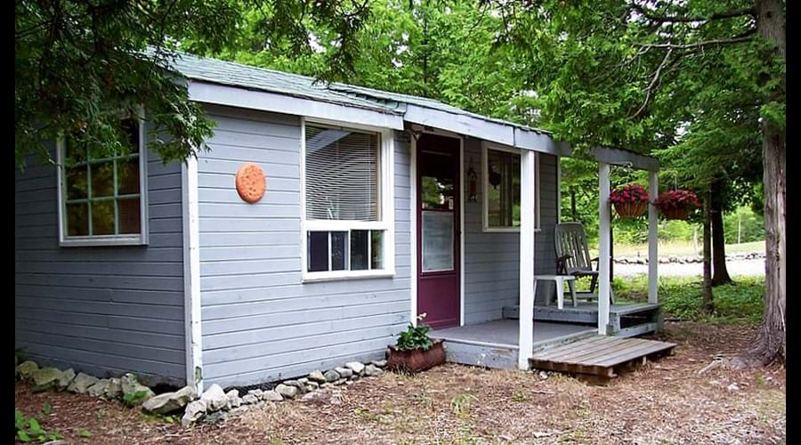 A view of the cozy one bedroom Guest Cabin. It is located just a few steps from the main cottage.