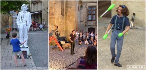 Street entertainers perform on or near Place de la Liberte
