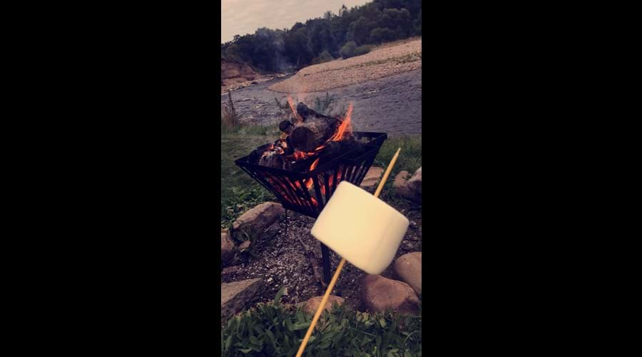 Roast marshmallows on the firepit down by the river