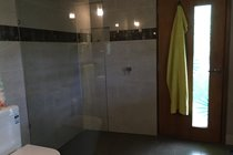 Large walk in shower with rainfall shower head....shower with a friend!