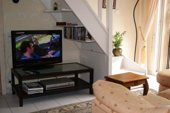 TV corner with DVD player and selection of DVD's