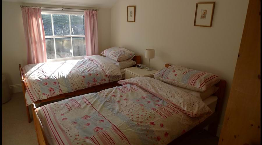 Bedroom 6:  Twin pine beds with wardrobe, chest of drawers and side table