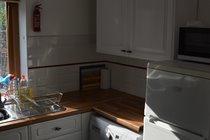 Kitchen with Washing Machine, Fridge Freezer and Microwave Oven
