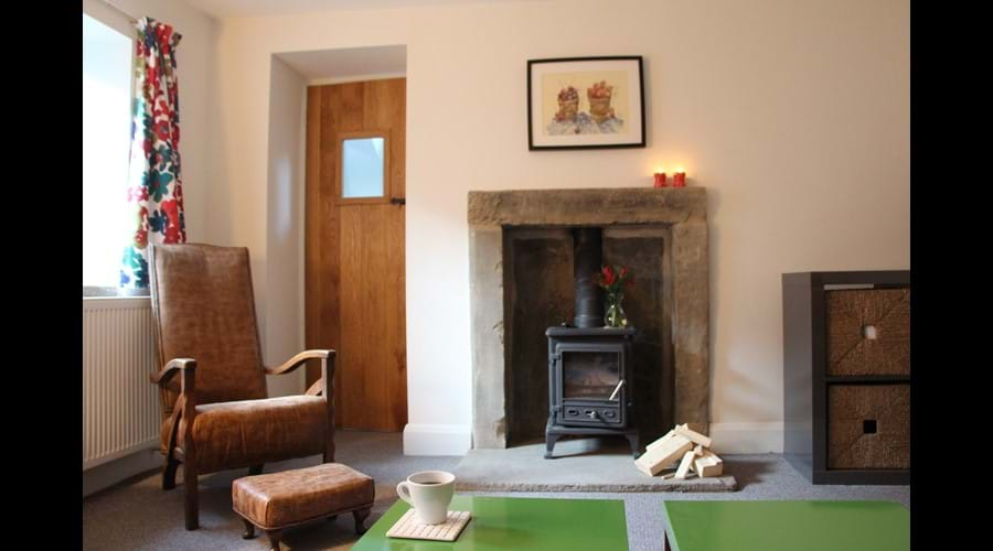 Sitting room showing stone fireplace