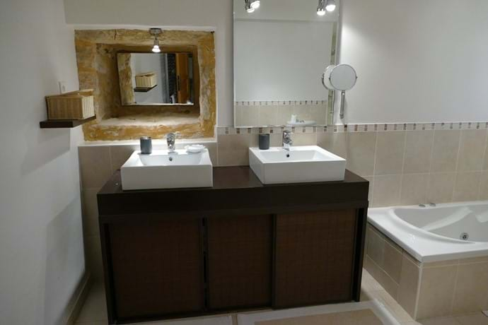 En suite bathroom for Bedroom One with double vanity unit